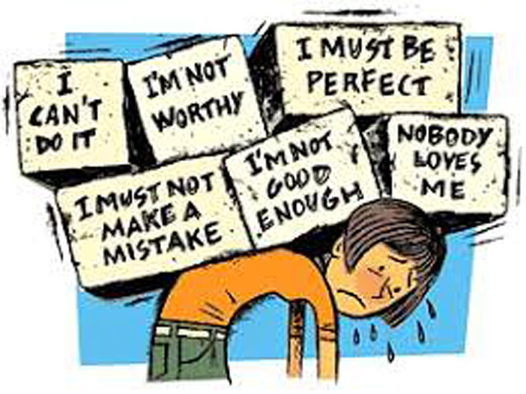 Animated drawing a figure wearing green trousers and an orange top bending over and struggling under the strain of having six boxes on their back. The boxes say 'I can't do it', 'I'm not worthy', 'I must be perfect', 'I must not make a mistake', 'I'm not good enough' and 'nobody loves me'.
